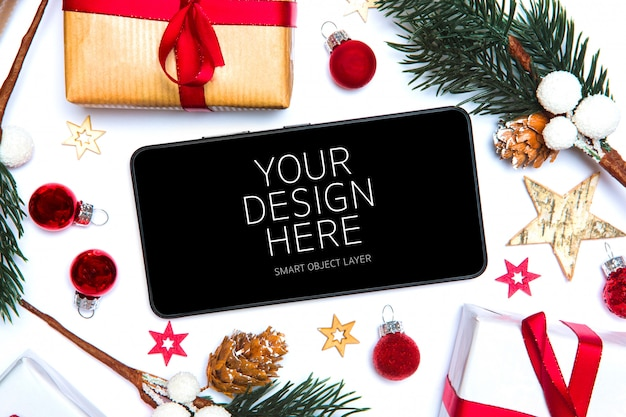 View of a christmas mobile app and decorations mockup Premium Psd