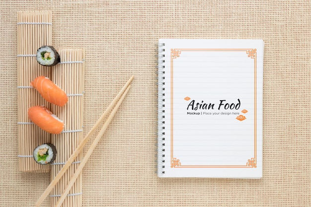 Above view sushi with chopsticks Free Psd