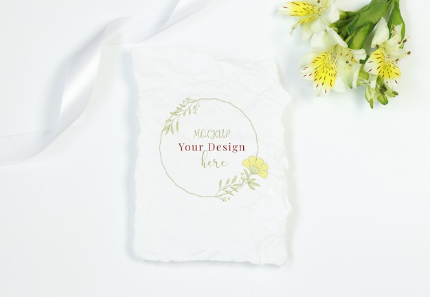 Vintage card with flowers and ribbon on white background Premium Psd
