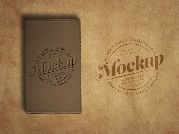 Vintage or retro logo mockup on old textured paper and lather diary