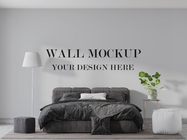 快適なベッドの後ろの壁のモックアップ Premium Psd