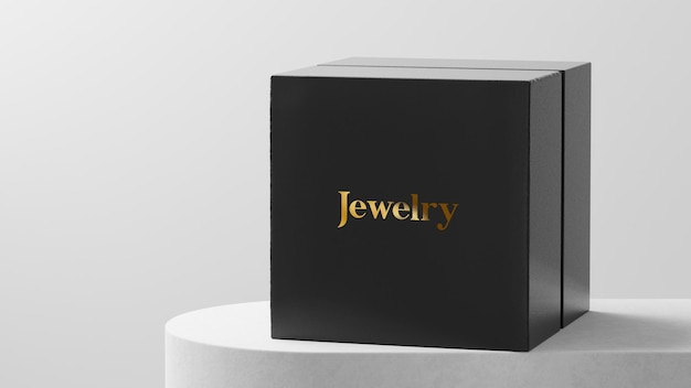 Watch or jewelry box logo mockup on white table Premium Psd
