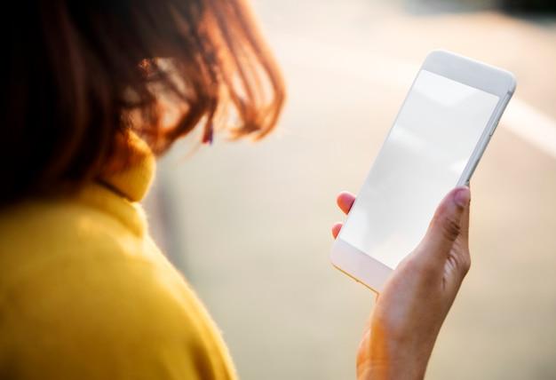 Watching texting using phone technology Premium Psd