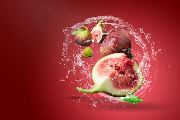 Water splashing on fresh figs over red Premium Psd