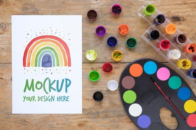 Watercolors set on desk Free Psd