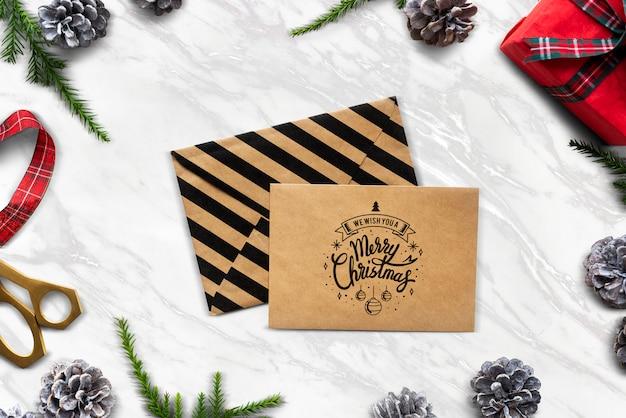 Vi auguriamo un mockup di merry christmas card Psd Gratuite