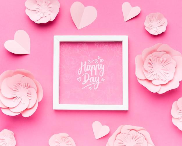 Mock-up cornice di nozze con fiori e cuori di carta Psd Gratuite