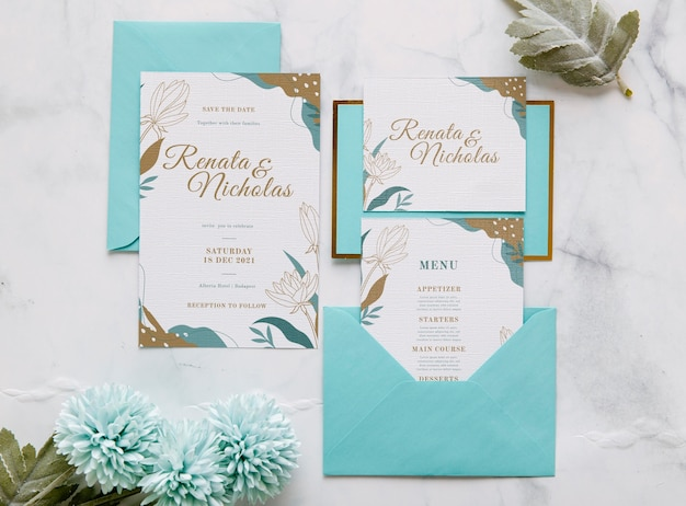 Wedding invitation with flowers and leaves Premium Psd