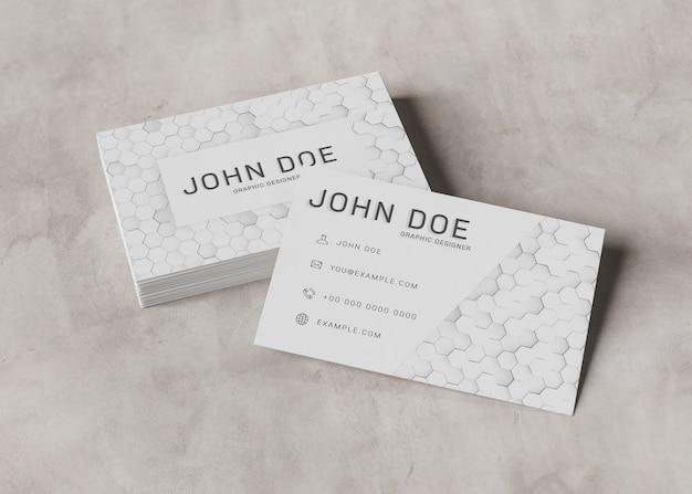 White business card piles on concrete surface mockup Premium Psd