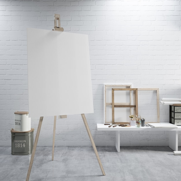 White canvas on a easel at the art room Free Psd