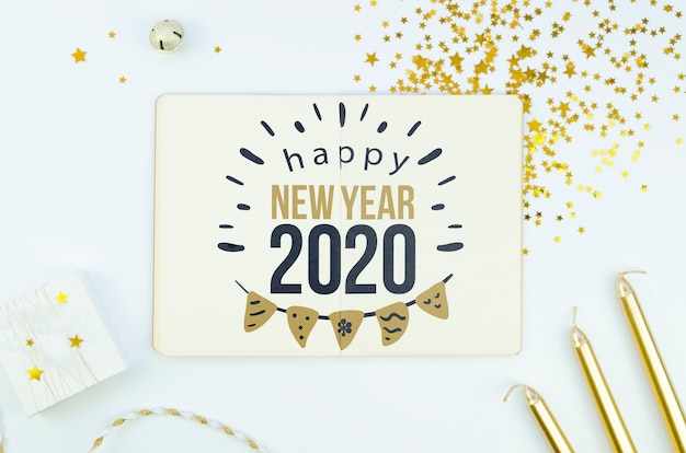 white card happy new year quote and golden accessories