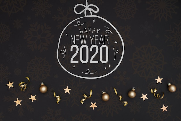 White chalkboard doodle christmas ball with new year 2020 text Free Psd