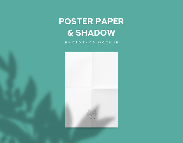 White fold poster paper or flyer a4 size and leaves shadow on green mint background Premium Psd