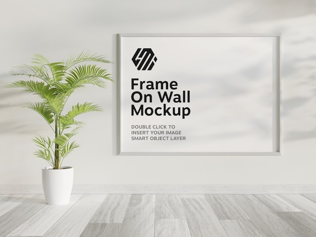 White frame hanging on wall mockup Premium Psd