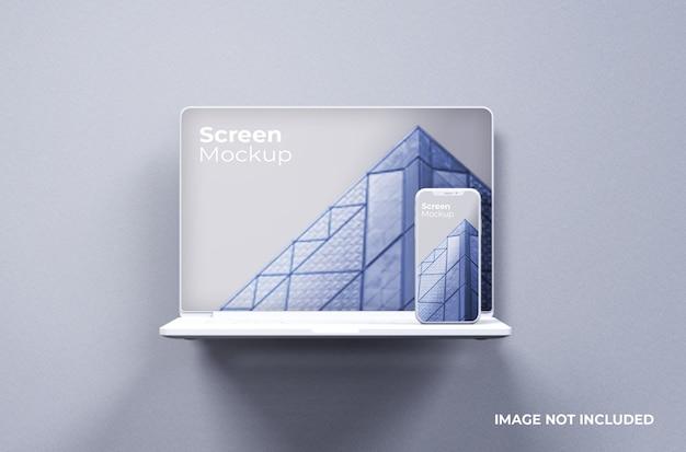 スマートフォンのモックアップ正面図と白いmacbookpro粘土 Premium Psd