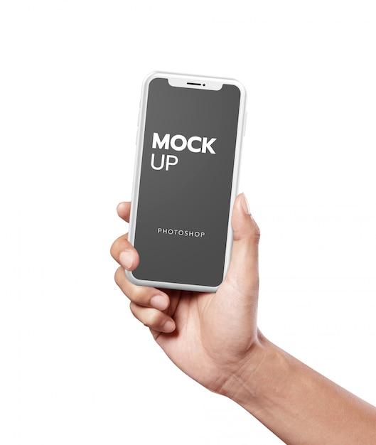 Белый телефон современный макет в руках Premium Psd