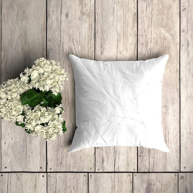 花飾り付きの木の板に白い枕カバーモックアップ 無料 Psd