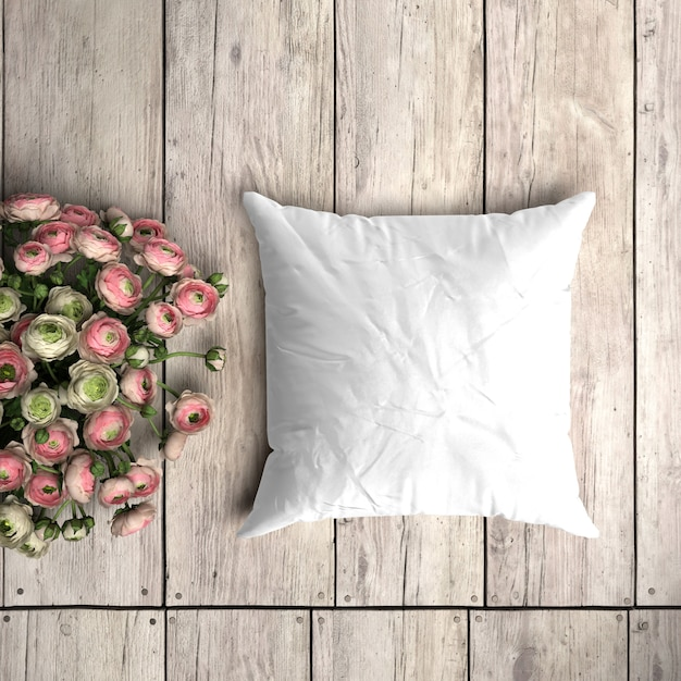 Modello bianco federa su una tavola di legno con decorazione floreale Psd Gratuite