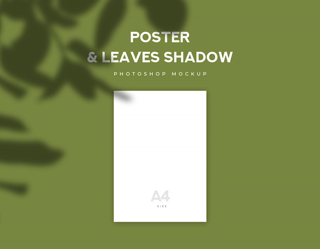 White poster paper or flyer a4 size and leaves shadow on olive green background Premium Psd