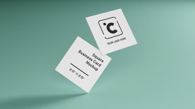 緑のミントパステルカラーテーブルイラストレンダリングにスタッキング白い正方形形名刺モックアップ Premium Psd