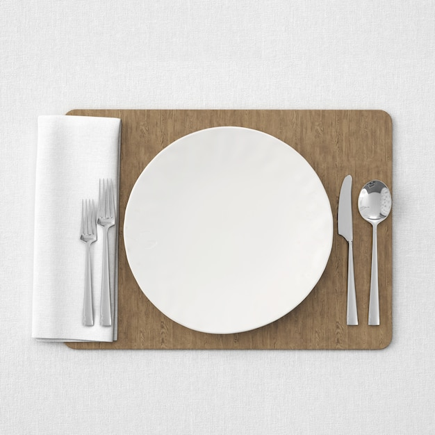 White table setting on wooden mat Free Psd
