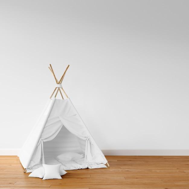 Tepee bianco sul pavimento di legno Psd Gratuite