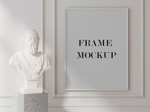 White wall frame mockup beside sculpture Premium Psd
