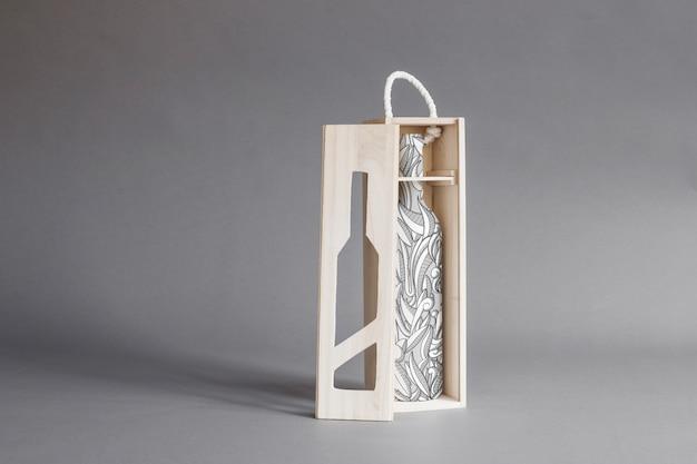 Wine bottle in wooden box mockup Free Psd