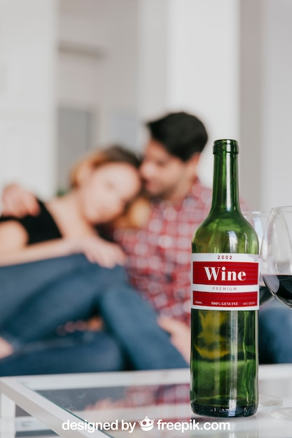 Wine mockup with couple on couch Free Psd