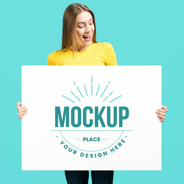 Woman holding a big banner ofstationery mock-up Free Psd