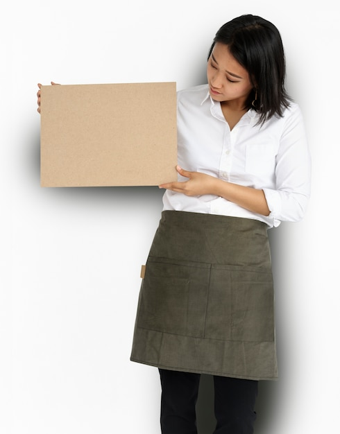 Woman holding cork board Free Psd