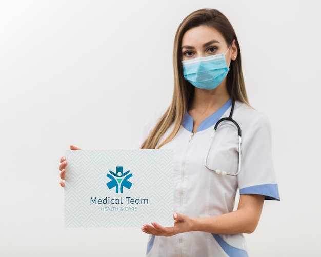 Woman holding medical mock-up card Free Psd