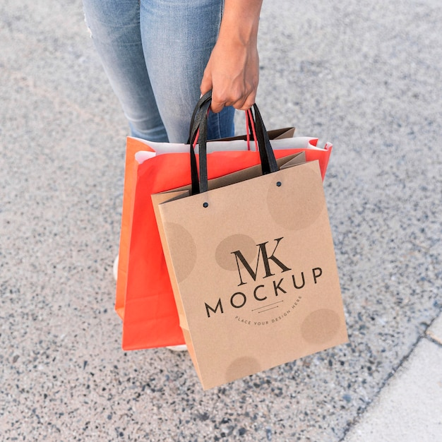 Woman holding mock-up shopping bags Free Psd