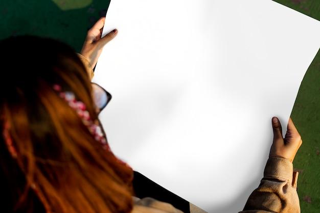 Woman holding placard copyspace empty Premium Psd