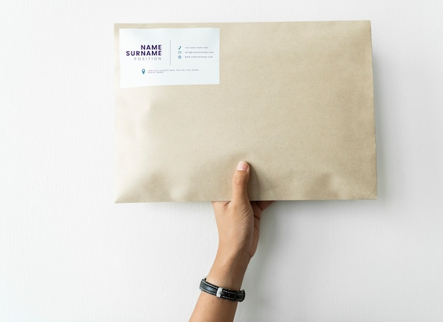 Woman holding up a package mockup Free Psd