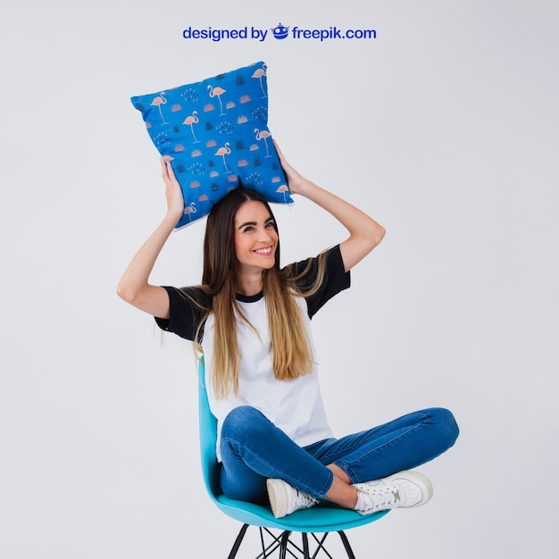 Woman on chair holding cushion Free Psd