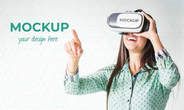 Woman playing a virtual reality game while wearing goggles Free Psd