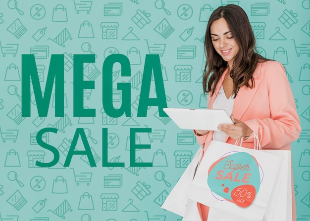 Woman shopping on mega sales camapaign Free Psd