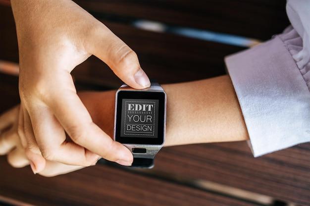 Woman using smart watch psd mockup Free Psd