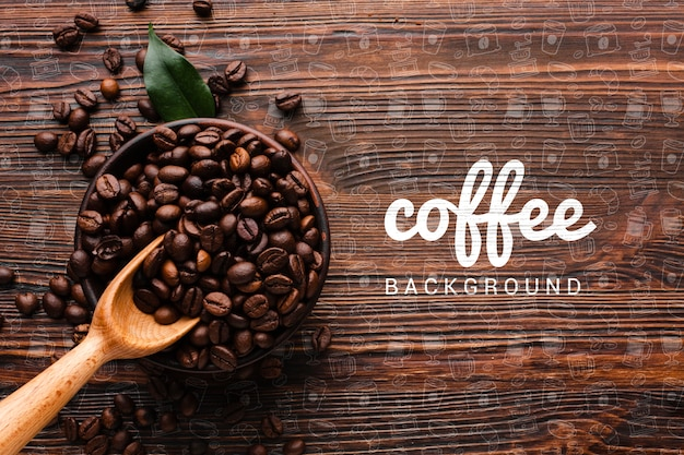 Wooden background with coffee beans Free Psd