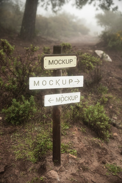 Wooden route signs mock-up in the forest Free Psd