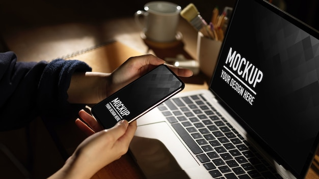 Workspace with digital phone and laptop mockup with mug Premium Psd