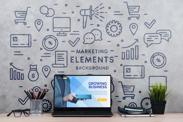 Workspace with plant and laptop Free Psd