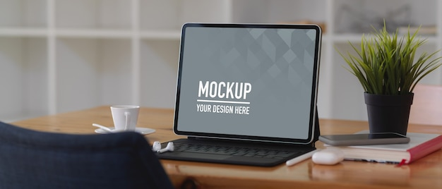 Worktable with digital tablet mockup, book and accessories Premium Psd
