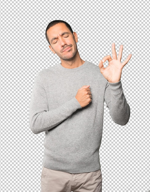 Worried young man doubting and making a gesture of approval Premium Psd
