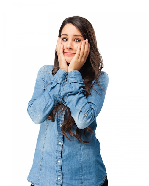 Worried young woman with hands on face Free Psd