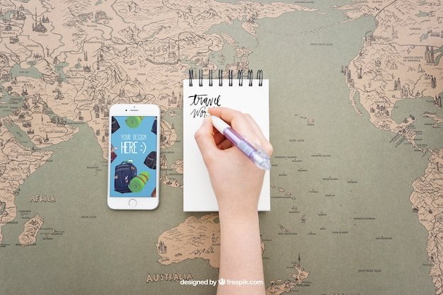 Writing on notepad and smartphone Free Psd