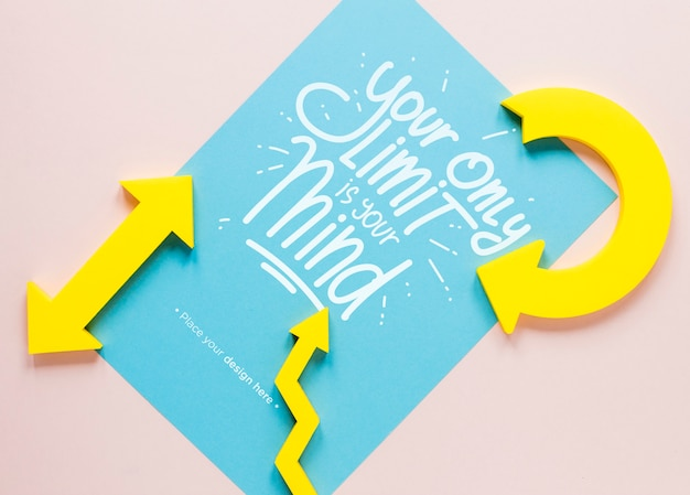 Yellow arrows and lettering on paper Free Psd