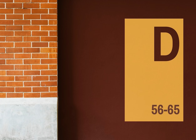 Yellow signboard mockup on a brown wall Free Psd