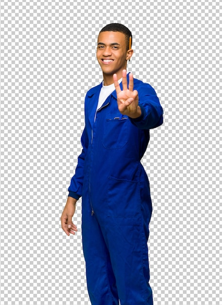Young afro american worker man happy and counting three with fingers Premium Psd